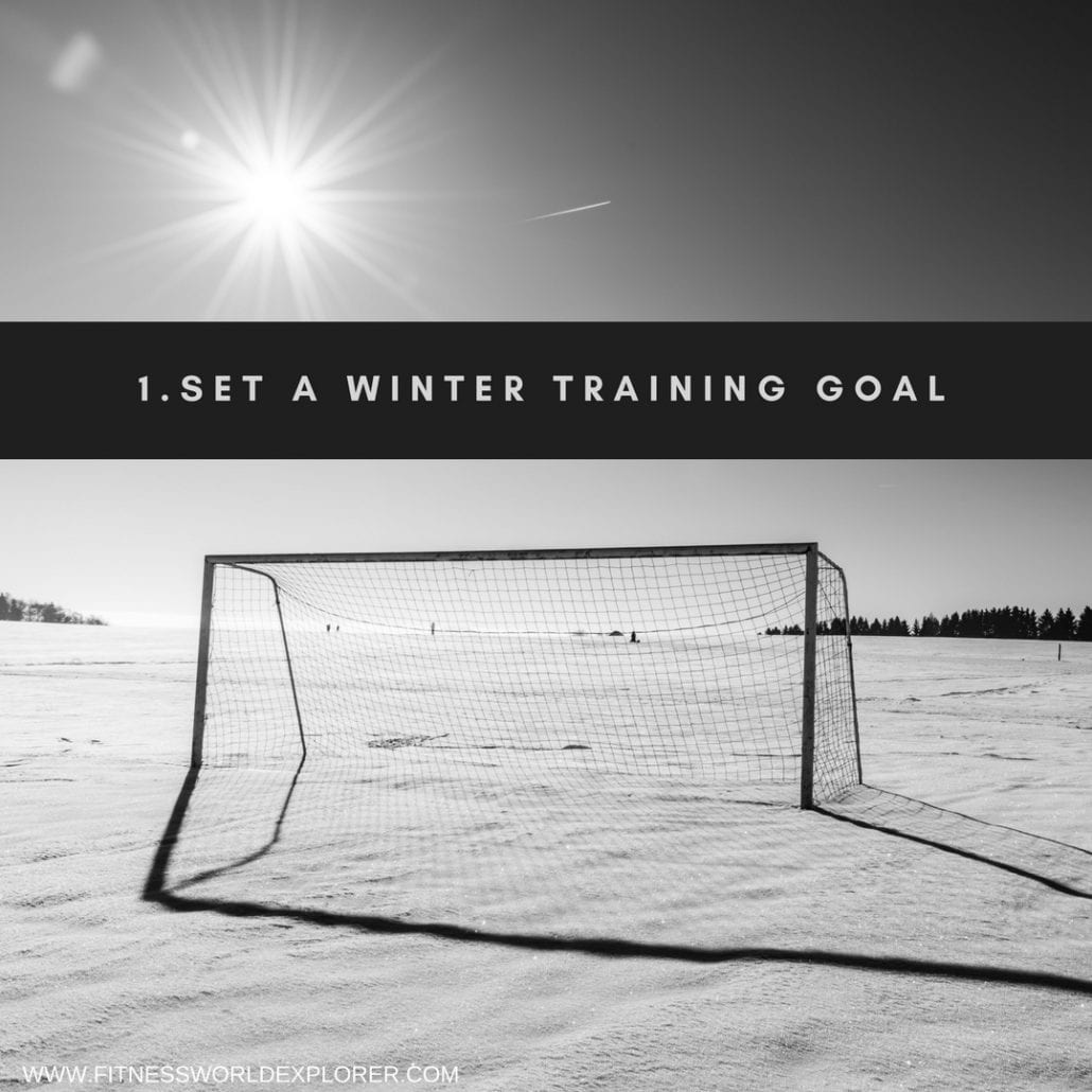 Picture of goal on snowy football pitch